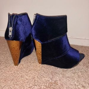 Chic velvet wedges in navy with gold heel accent.